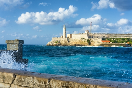 The famous castle of El Morro in Havana with a stormy weather and big waves in the ocean photo