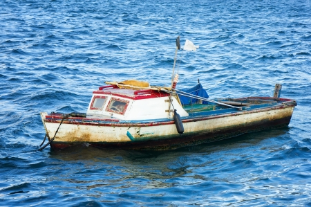 Small fishing boat anchored in the bay of Havana photo
