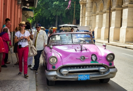tourist icon: Old car waiting for tourists at El Floridita restaurant in Havana