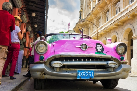 Old car waiting for tourists at El Floridita restaurant in Havana