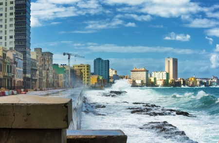 Skyline of Havana during a hurricane with big waves crashing against the seaside wall