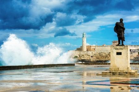 The castle of El Morro in Old Havana among huge sea waves