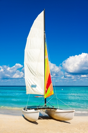 Colorful sailing boat in the cuban beach of Varadero photo