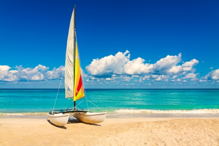 Sailing boat on a beautiful summer day at beach in Cuba photo