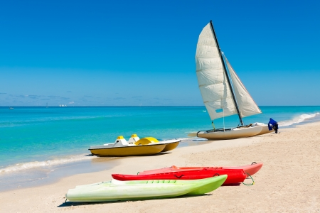 Sailing boats and kayaks on the beautiful beach of Varadero in Cuba photo