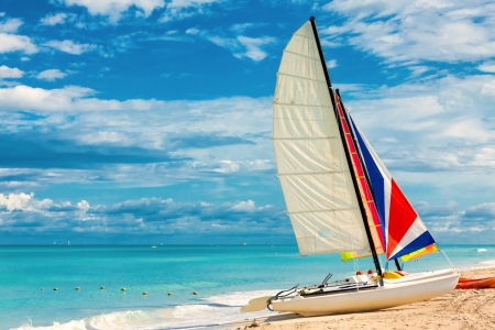 Sailing boat on a beautiful summer day at Varadero beach in Cuba photo