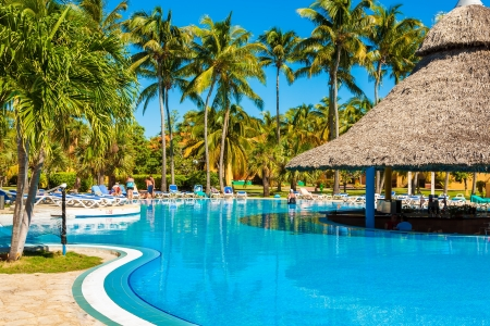 pool bars: Beautiful outdoors pool surrounded by palms in Varadero