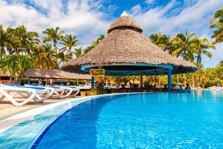 pool bars: Beautiful pool with a bar at the center in Varadero