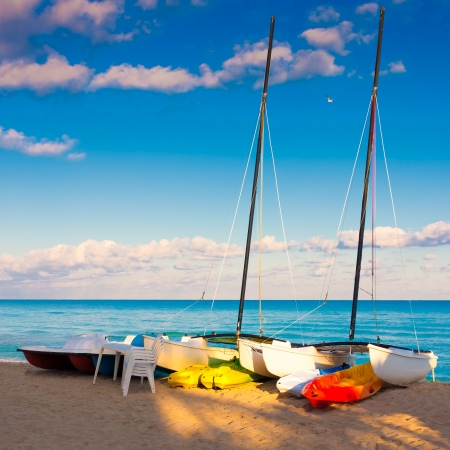 Catamarans, kayaks and pedalos in the cuban beach of Varadero photo