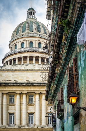 Shabby crumbling  building in Havana with the dome of the Capitol in the background Stock Photo - 16616581