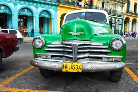 chevy: Old classic Chevrolet  in Havana Thousands of these vintage cars are still in use in Cuba and they have become an iconic view and a worldwide known attraction