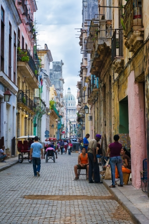 capitolio: Street in the old neighborhood with the Capitol in the distance in Havana Founded in 1515,Havana is the largest city in the Caribbean with 2 4 million inhabitants Editorial