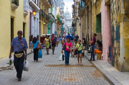inhabitants: Street in the old neighborhood with the Capitol in the distance  in Havana Founded in 1515,Havana is the largest city in the Caribbean with 2 4 million inhabitants Editorial