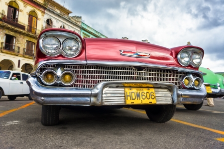 chevrolet: Low angle view of an old Chevrolet  in Havana Thousands of these cars are still in use in Cuba and they have become an iconic view and a worldwide known attraction