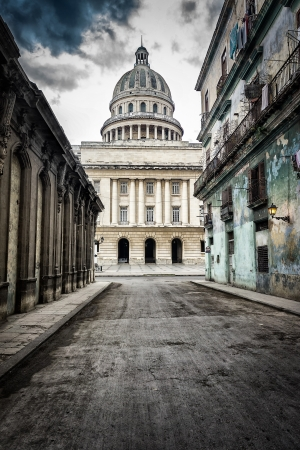 Grungy street with crumbling buildings leading to the Capitol in Old Havana Stock Photo - 16753263