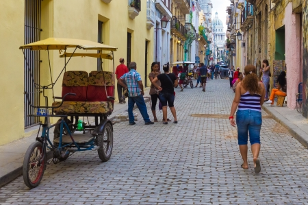 Cuban people in the street on an old neighborhood in Havana Founded in 1515,Havana is the largest city in the Caribbean with 2 4 million inhabitants Stock Photo - 16680151