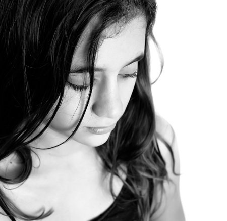 drama: Black and white portrait of a beautiful sad hispanic girl isolated on a white background with space for text
