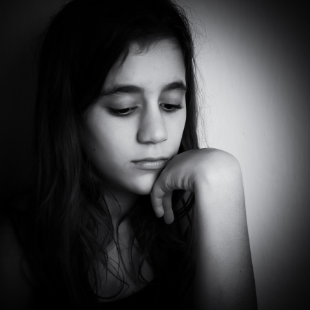 Dramatic black and white portrait of a sad and lonely child Stock Photo - 16795218