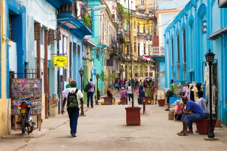 habana: Street scene with cuban people and colorful old buildings in Havana