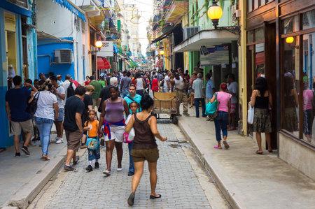 People in the popular commercial street of Obispo in Havana