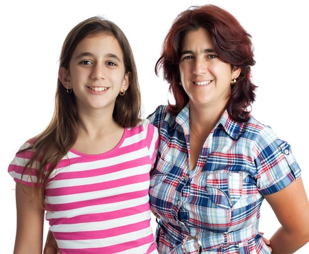 Young hispanic woman and her teenage daughter hugging isolated on white