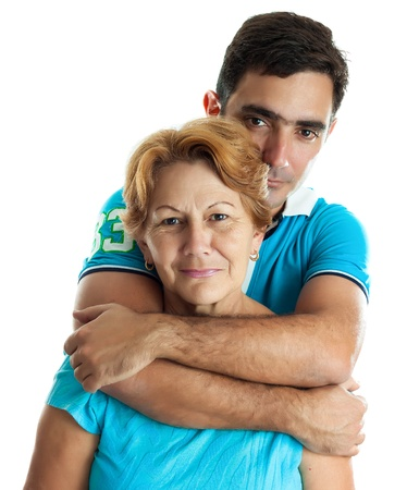 Latin man: Young hispanic man hugging his mother isolated on white