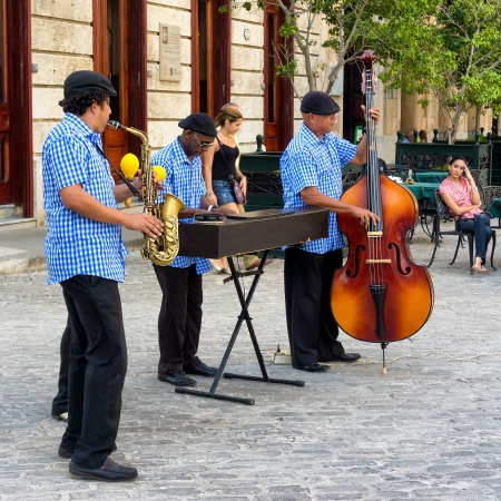 street musician: Traditional band playing for tourists in Havana Famous through the world,the cuban music is an attraction for more than 2 million people who visit Cuba every year Editorial
