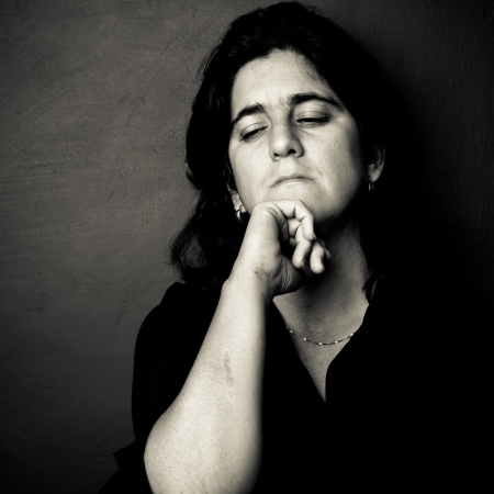 Dramatic black and white portrait of a worried and depressed woman photo