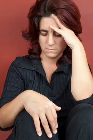 abused women: Portrait of a very stressed hispanic woman