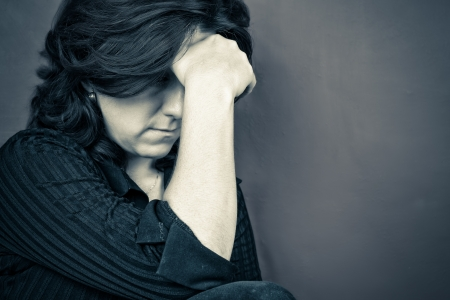 blue toned: Blue toned portrait of a depressed woman Stock Photo