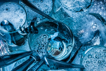 Detail of blue toned cutlery and glasses being washed with water and detergent Stock Photo - 17702995