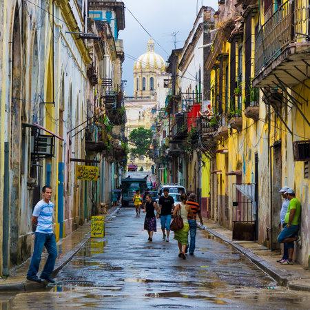 Revolution: Cuban people in a typical old neighborhood in Havana