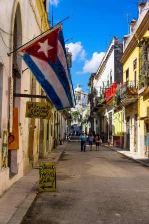 Typical street in Old Havana with a big cuban flag Stock Photo - 18114070