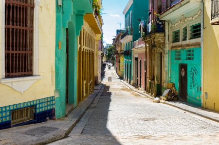 Narrow street sidelined by colorful buildings in Old Havana Stock Photo - 18268171