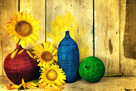 Vintage image of sunflowers and pottery with  a rustic wood planks background Stock Photo - 18280736