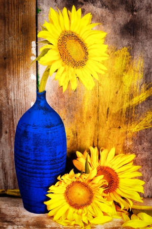 Sunflowers on a blue vase with a grunge rustic wood planks  background Stock Photo - 18280669