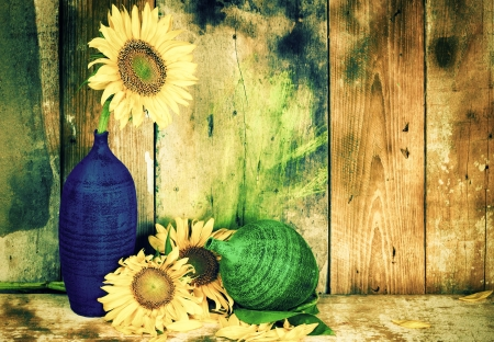 Vintage image of flowers and pottery vases on a rustic wooden background photo