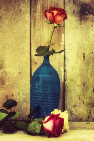 Vintage image of roses on a rustic wooden background Stock Photo - 18860417