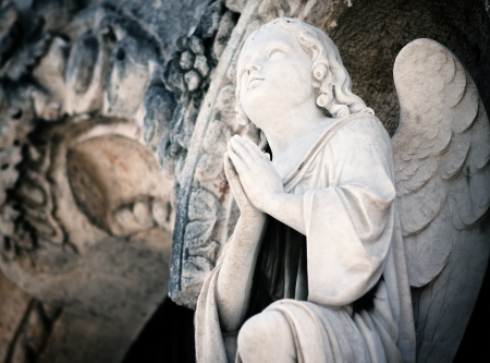 mourn: Beautiful marble angel praying