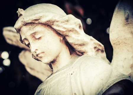 angel cemetery: Vintage image of a sad and beautiful angel