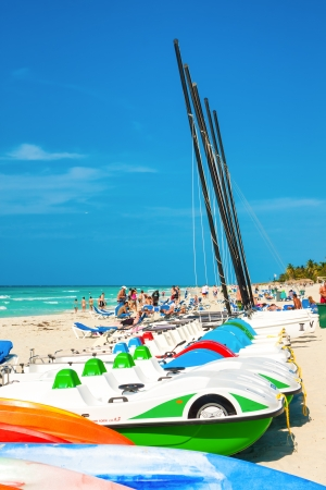 consolidated: Recreational marina and tourists enjoying the beach April 7,2013 in Varadero With a growth of 4 5  in 2012,tourism has consolidated as a primary source of income for Cuba Editorial