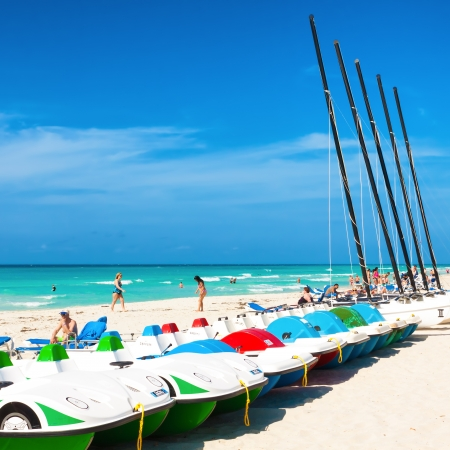 consolidated: Boats for rent and tourists enjoying the beach April 7,2013 in Varadero With a growth of 4 5  in 2012,tourism has consolidated as a primary source of income for Cuba
