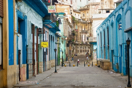 People in an old decaying neighborhood April 4,2013 in Havana With 2 4 million inhabitants,Havana is the capital and the largest city in Cuba as well as its main touristic destination Stock Photo - 19295126