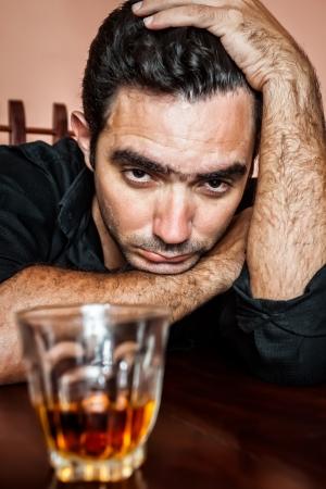 Portrait of a drunk and depressed hispanic man Stock Photo - 19377546