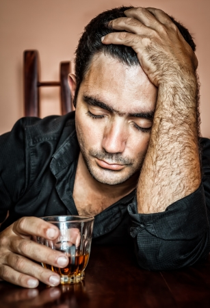 Alcoholism   Portrait of a lonely and desperate drunk hispanic man