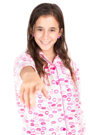 Hispanic girl wearing pajamas and pointing a finger at the camera  isolated on white