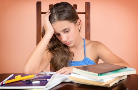failing: Tired hispanic student  exhausted after studying too much or failing to understand the lesson Stock Photo