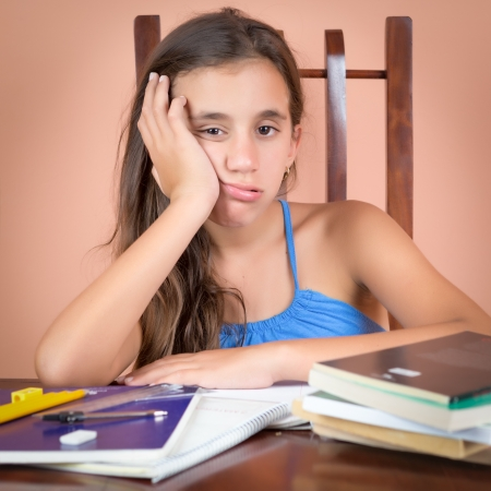 Tired hispanic student  with a bored expression Stock Photo
