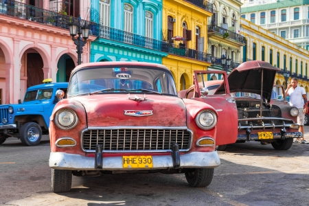 Old Chevrolet parked near a row of colorful buildings on June 21, 2013 in Havana