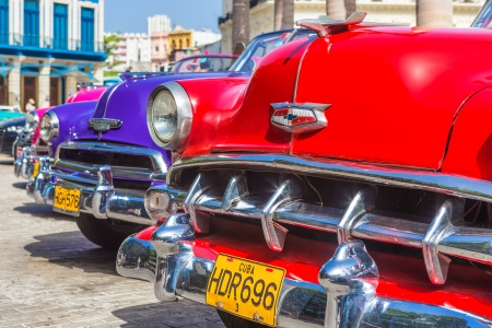 Colorful row of vintage american cars on June 21, 2013 in Havana Stock Photo - 20449616